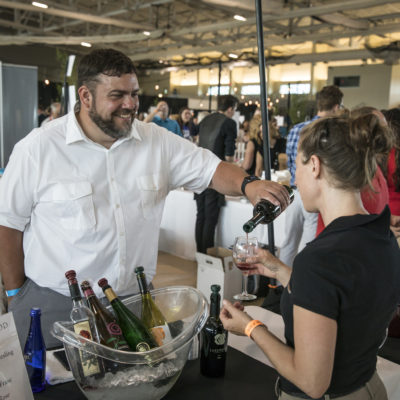 Man serving wine to guest